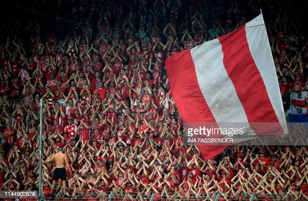 TOPSHOT Union Berlin's supporters celebrate their team during the German second division Bundesliga football match VfL Bochum v 1 FC Union Berlin in...