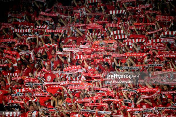 Union Berlin's supporters celebrate their team during the German second division Bundesliga football match VfL Bochum v 1 FC Union Berlin in Bochum...