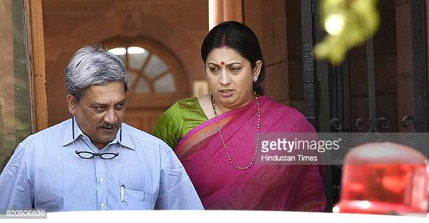 Union Cabinet Minister for Defence Manohar Parrikar along with Union Minister for Human Resource Development Smriti Irani coming out after attending...