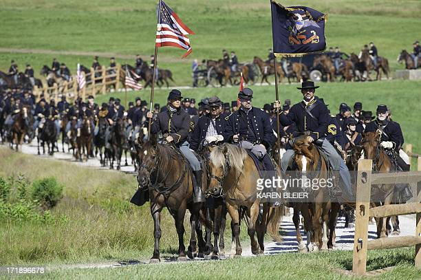 Union Cavalry arrives at the battlefield during a reenactment of the Battle of Gettysburg on June 29 at the start of the 150th Gettysburg celebration...