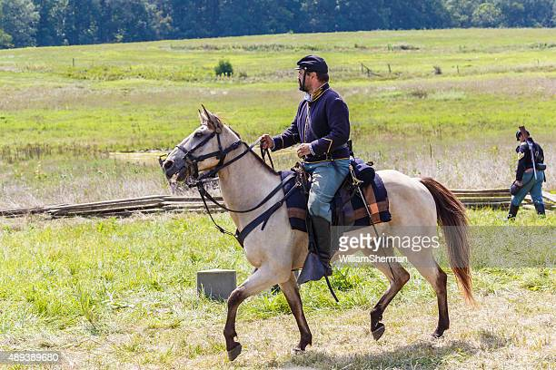 union cavalry soldier rides off to battle - gunshot wound stock photos and pictures