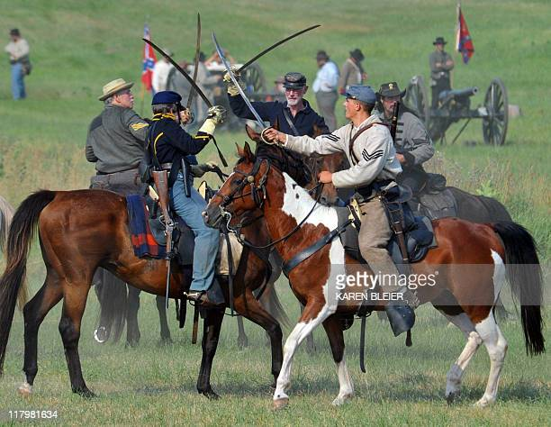 Union cavalry troops engage Confederate cavalry with sabers during the Battle at the Sherfy House on July 2, 2011 during re-enactments of battles...