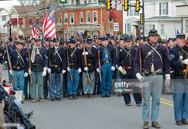 CONTENT] Union Civil War reenactors in the Remembrance Day Parade in Gettysburg celebrating 150th Anniversary of the Gettysburg Address