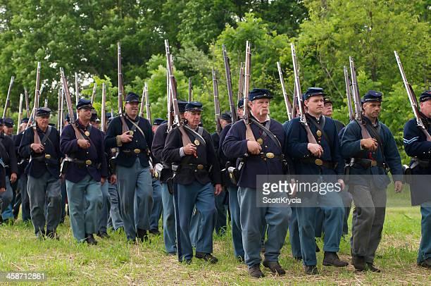 union civil war renactors march to the battle - civil war stock pictures, royalty-free photos & images