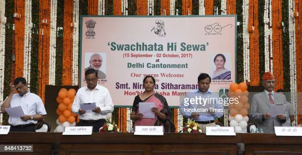 Union Defence Minister Nirmala Sitharaman and Defence Secretary Sanjay Mitra and other defence persons takes oath during the 'Swachhta Hi Seva'...