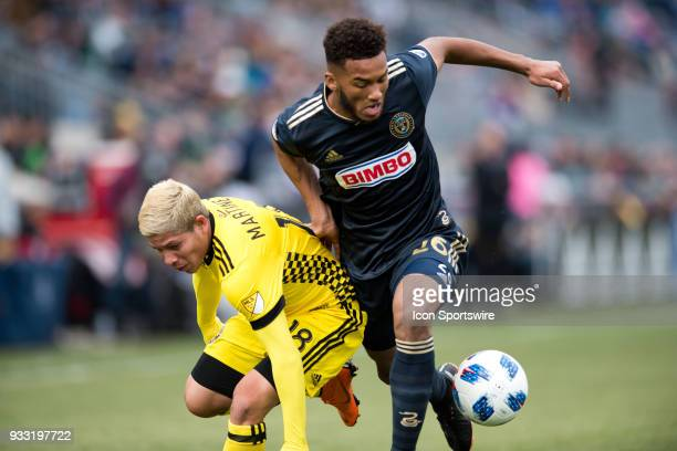 Union Defender Auston Trusty and Columbus Crew Midfielder Cristian Martinez collide while trying to collect the ball in the first half during the...