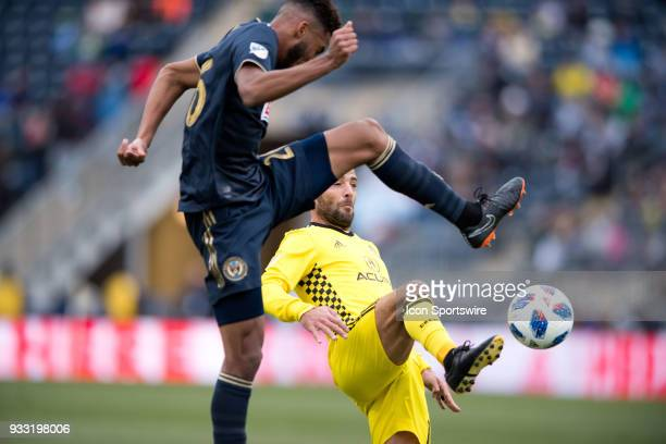 Union Defender Auston Trusty and Columbus Crew Midfielder Federico Higuain leap for the ball in the first half during the game between the Columbus...