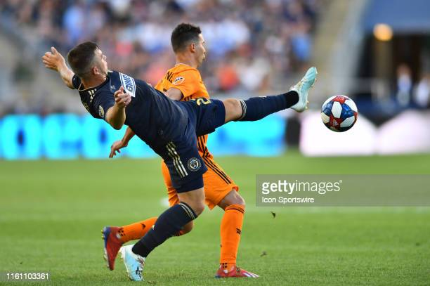 Union Defender Kai Wagner reaches across Dynamo Midfielder Tomas Martinez for the ball in the second half during the game between the Houston Dynamo...
