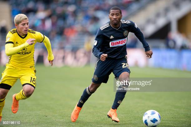 Union Defender Raymon Gaddis carries the ball away from Columbus Crew Midfielder Cristian Martinez in the second half during the game between the...