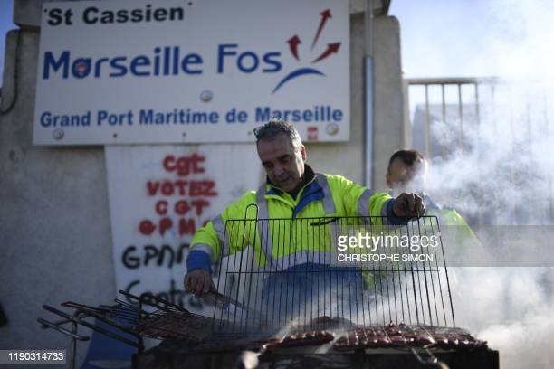 CGT union dockers and rail workers attend a Christmas lunch on December 24 2019 at the autonomous port of Marseille on the 20th day of a nationwide...