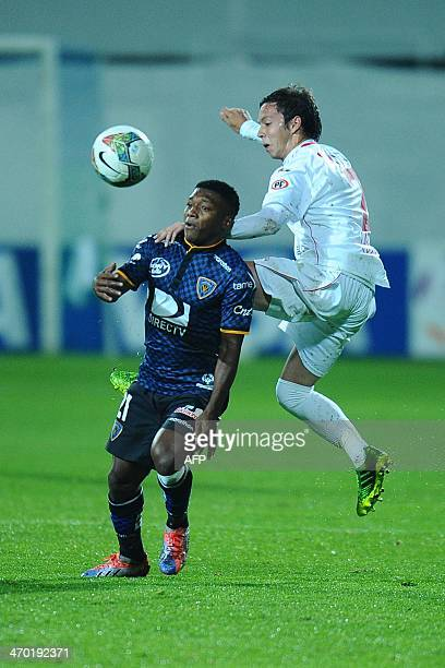 Union Espanola's Mario Larenas vies for the ball with Independiente del Valle's Jonathan Gonzalez during their 2014 Copa Libertadores football match...