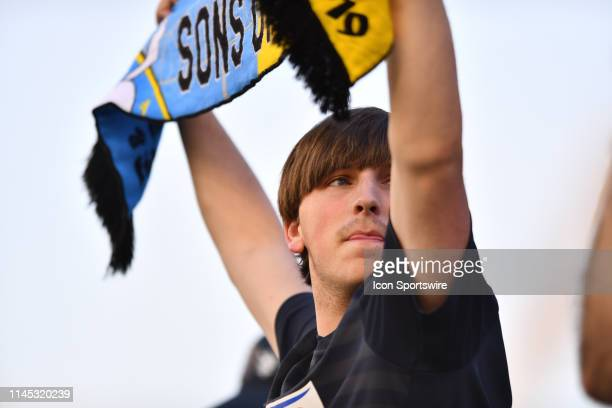 Union fan holds a scarf before the game between the Seattle Sounders and Philadelphia Union on May 18 2019 at Talen Energy Stadium in Chester PA