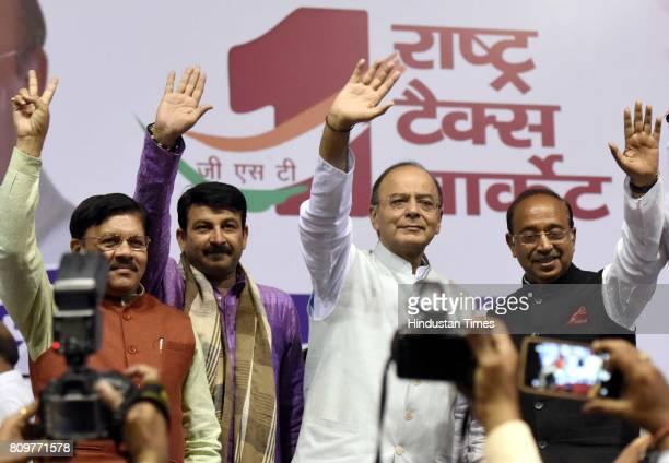 Union Finance and Defence Minister Arun Jaitley with Delhi BJP President Manoj Tiwari and Union Minister of sports Vijay Goel during the GSTDelhi...