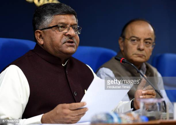 Union Finance Minister Arun Jaitley and Minister of Law and Justice Ravi Shankar Prasad address a press conference briefing after cabinet meeting at...