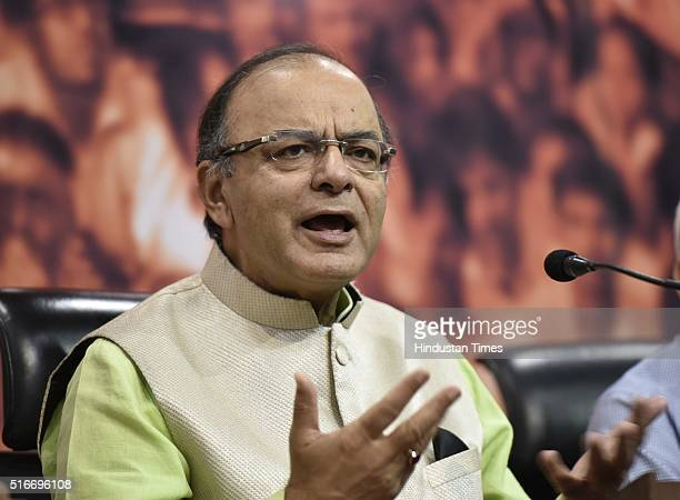 """Union Finance Minister Arun Jaitley during a press conference at BJP HQ on March 20 2016 in New Delhi India Jaitley said """"Freedom of expression and..."""