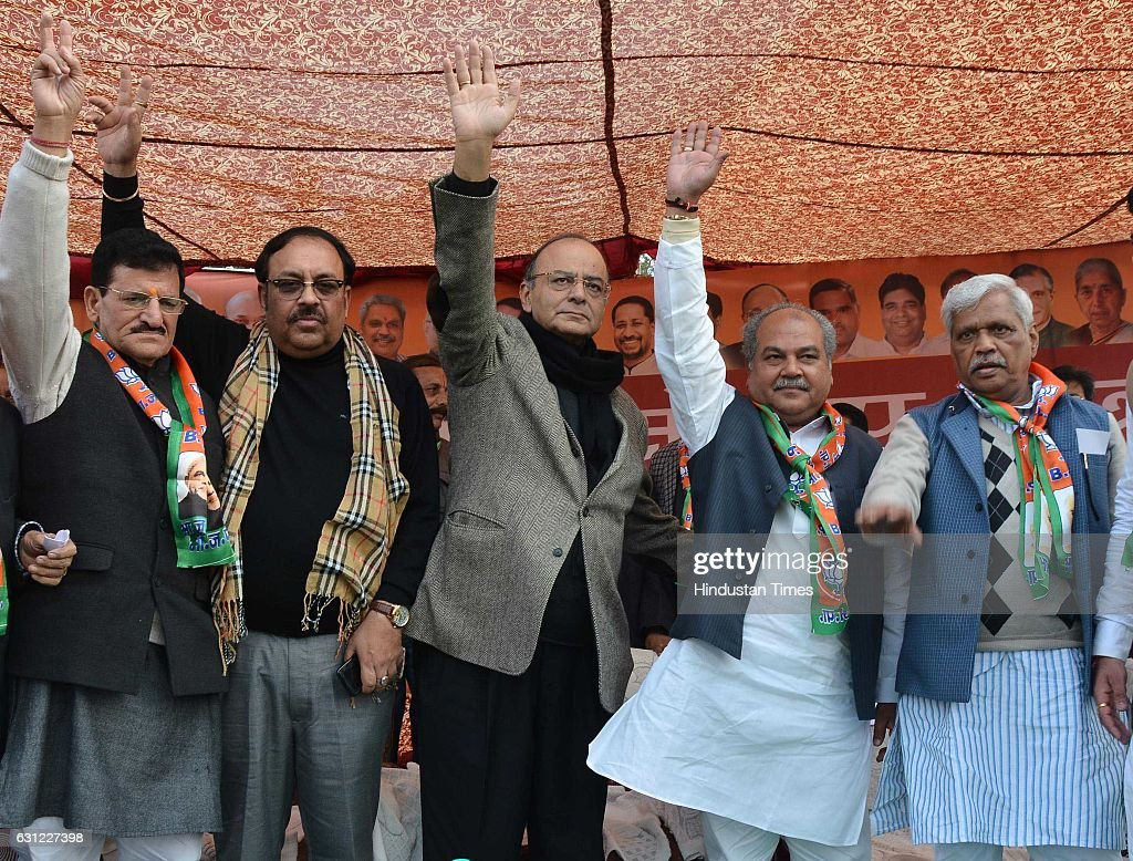Union Finance Minister Arun Jaitley Narendra Singh Tomar Minister for State for Rural Development Rajya Sabha MP Shwait Malik during a rally held to..