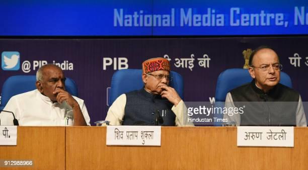 Union Finance Minister Arun Jaitley with Radhakrishnan P and Shiv Pratap Shukla address a post budget press conference at National Media Center on...