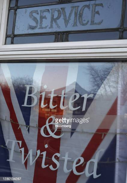 Union flag, also known as a Union Jack, in the window of the closed Bitter and Twisted micro pub in Coalville, U.K., on Monday, Dec 14, 2020. U.K....