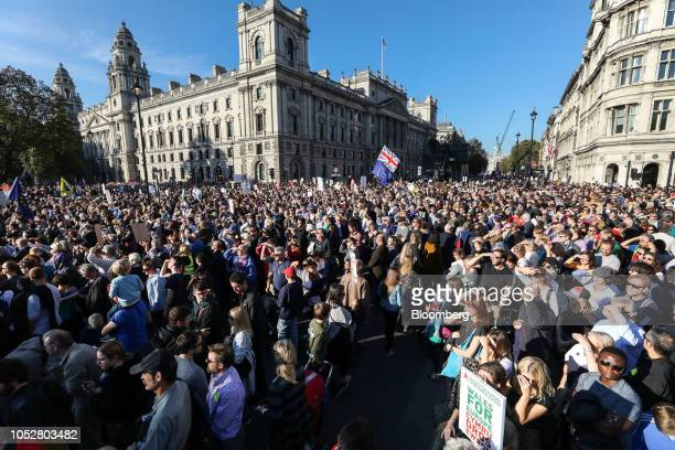 A Union flag also known as a Union Jack stands above crowds of demonstrators as they listen to speeches on Parliament Square following the antiBrexit...