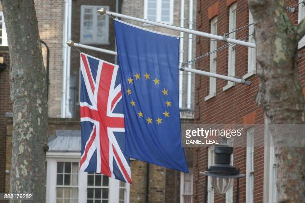 A Union Flag and an EU Flag are seen flyin together in London on December 8 2017 after a significant breakthrough was made in the divorce...