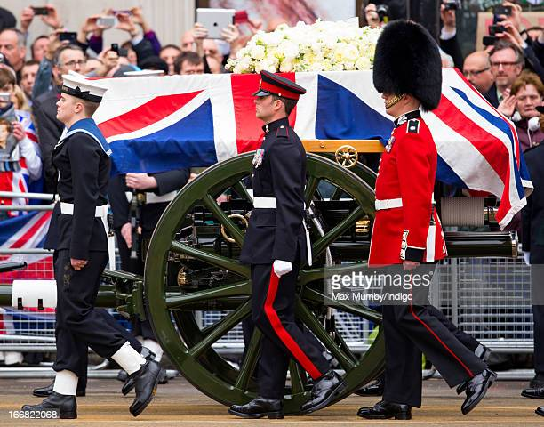 A Union Flag draped coffin bearing the body of former British Prime Minister Margaret Thatcher is carried on a gun carriage drawn by the King's Troop...