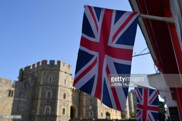 Union flag flies above the window of a Souvenir Shop opposite Windsor Castle in Windsor, west of London, on April 13 following the April 9 death of...