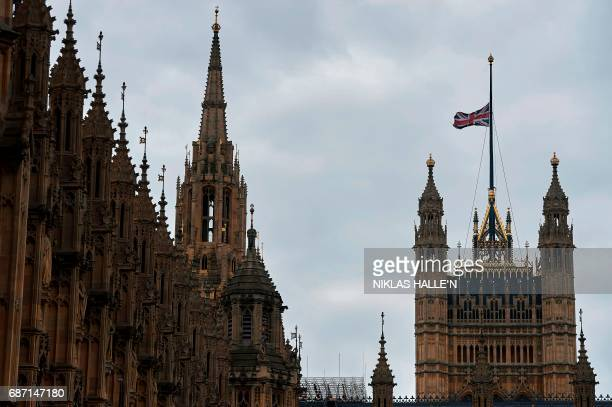 Union flag flies at halfmast from a flagpole above the Houses of Parliament in London on May 23 as a mark of respect to those killed and injured in...