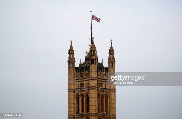 A Union flag flies atop the the Victoria Tower at Britain's Houses of Parliament incorporating the House of Lords and the House of Commons in central...