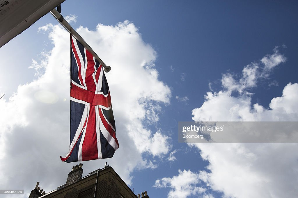A Union flag flies from a commercial real estate building that forms part of the Pollen Estate, on Savile Row in London, U.K., on Monday, Aug. 11, 2014. Norway's sovereign wealth fund, Norges Bank Investment Management, the world's largest, bought a stake in the Pollen Estate in London's Mayfair district for 343 million pounds ($576 million), expanding its property holdings in the U.K. capital. Photographer: Jason Alden/Bloomberg via Getty Images