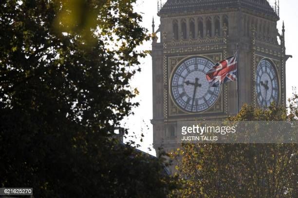 A Union flag flies from a flagpole near to the Elizabeth Tower also known as Big Ben at the Houses of Parliament in central London on November 7 2016...