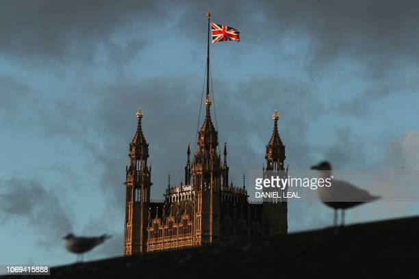A Union flag flies from atop the Victoria Tower of the Palace of Westminster in central London on December 7 2018 British MPs will hold a crucial...