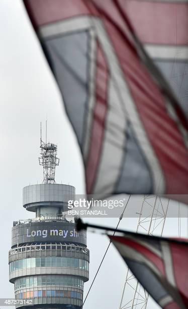 A Union Flag flies in front of the BT Tower displaying the words ' Long may she reign' to pay tribute to Queen Elizabeth II becoming Britain's...