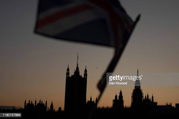 Union Flag flies in front of The Houses of Parliament at sunset on October 22 2019 in London England Prime Minister Boris Johnson published his...