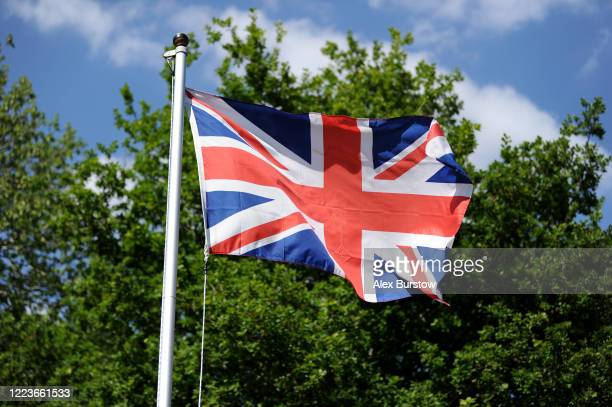 Union Flag flies in the wind in the grounds of the Christ Church Crookham on May 08 2020 in Church Crookham United Kingdom The UK commemorates the...