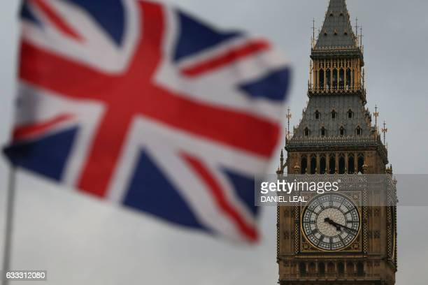 A Union flag flies near the The Elizabeth Tower commonly known Big Ben and the Houses of Parliament in London on February 1 2017 British MPs are...