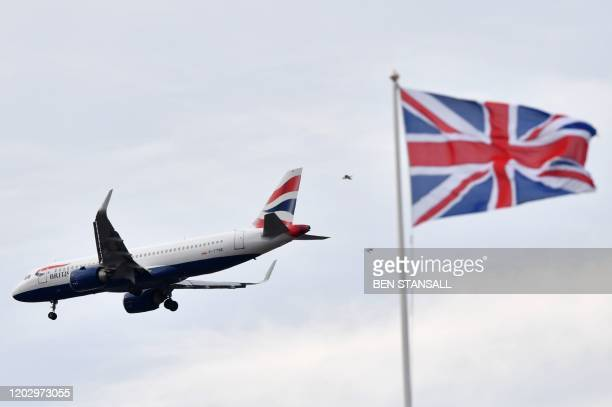 A Union flag flutters in the breeze as a British Airways passenger plane comes into land at Heathrow during the Six Nations international rugby union...