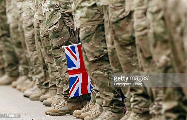 Union flag hangs between an honour guard of soldiers as crowds await the arrival of Johnson Beharry VC carrying the Olympic torch at the National War...