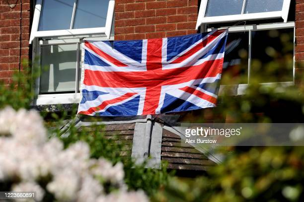 Union Flag is displayed outside a house to commemorate the 75th Anniversary of Victory in Europe Day on May 08 2020 in Church Crookham United Kingdom...