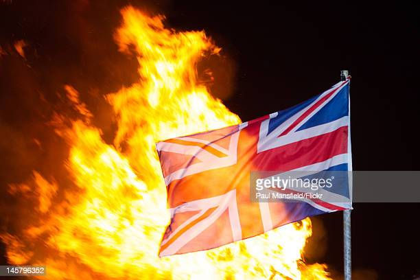 A union flag is illuminated by flames after the lighting of the Beacon at Rottingdean June 4 2012 to celebrate the Diamond Jubilee of Queen Elizabeth...