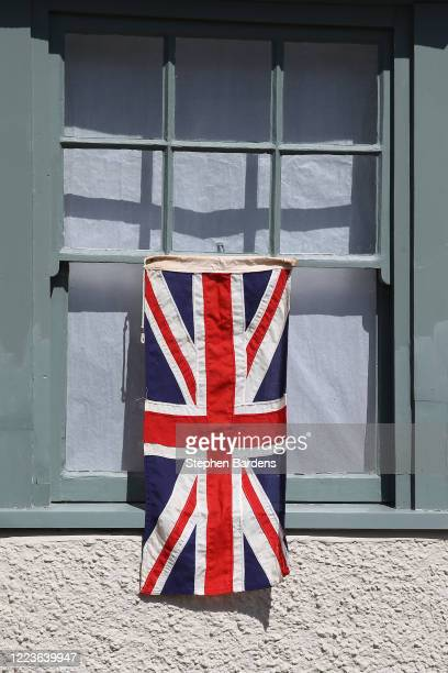 Union flag is seen hanging outside a house on May 08 2020 in Rottingdean United Kingdom The UK commemorates the 75th Anniversary of Victory in Europe...