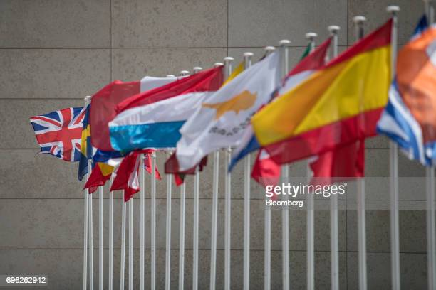 A Union Flag known as the Union Jack left flies beside other European national flags during a Eurogroup meeting of European finance ministers in...