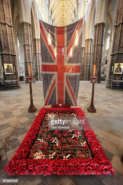 Union Flag which was used to cover the bodies of dead soldiers during the First World War is lowered above the Grave of the Unknown Warrior after the...