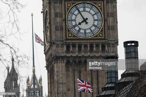Union flags also known as Union Jacks fly at halfmast outside the Palace of Westminster and the Elizabeth Tower commonly referred to as Big Ben in...