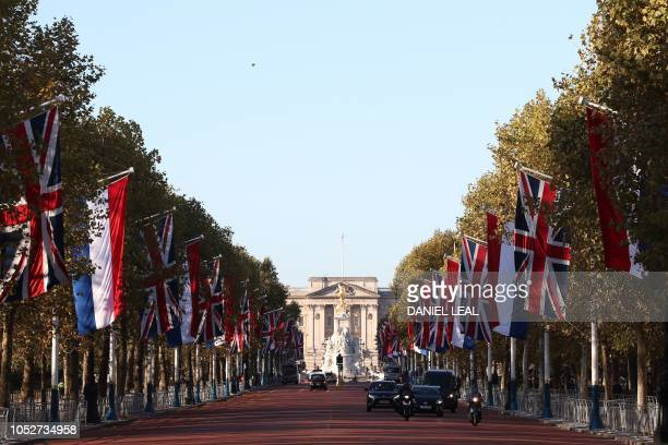 Union Flags and Dutch national flags decorate The Mall leading to Buckingham Palace in central London on October 22 2018 on the eve of the state...