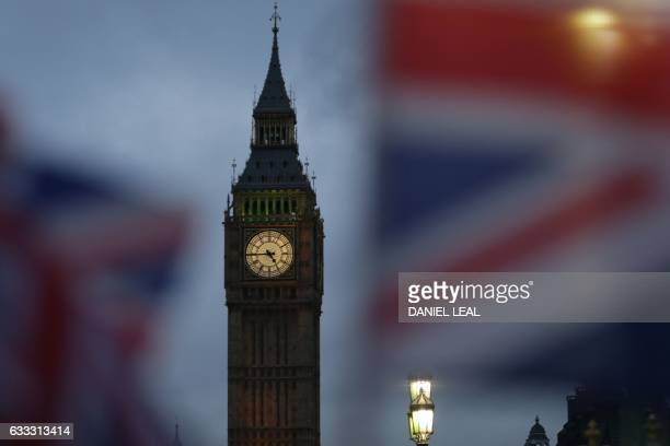 Union flags fly near the The Elizabeth Tower commonly known Big Ben and the Houses of Parliament in London on February 1 2017 British MPs are...