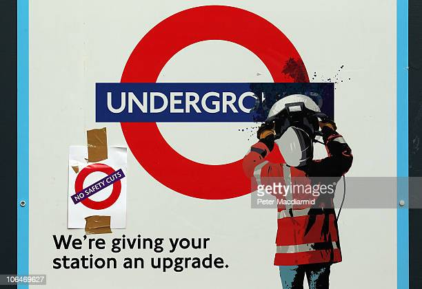 A union flyer calling for no saftey cuts is stuck on a poster advertising upgrades to the Underground at Victoria Station on November 3 2010 in...