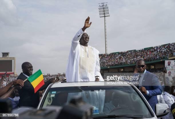 Union for the Republic and Democracy Union pour la république et la démocratie leader Soumaïla Cissé waves as he greets supporters at a rally during...