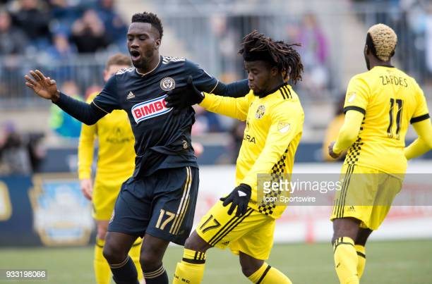 Union Forward CJ Sapong and Columbus Crew Defender Lalas Abubakar come together in front of the goal in the second half during the game between the...
