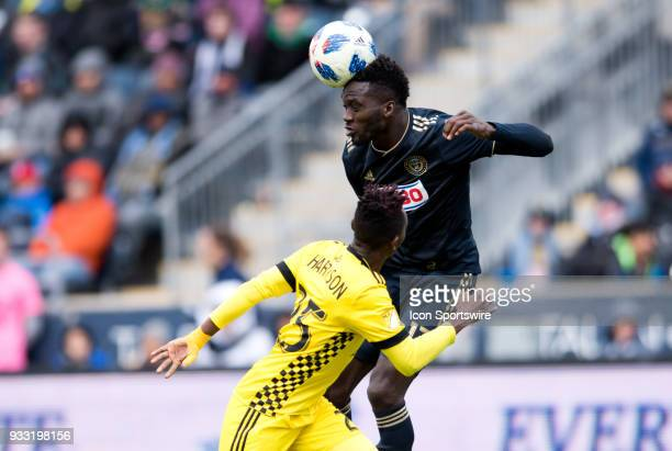Union Forward CJ Sapong gets a header over Columbus Crew Defender Harrison Afful in the second half during the game between the Columbus Crew and...