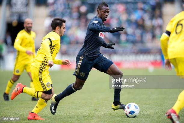 Union Forward Cory Burke carries the ball past Columbus Crew Defender Milton Valenzuela in the second half during the game between the Columbus Crew...